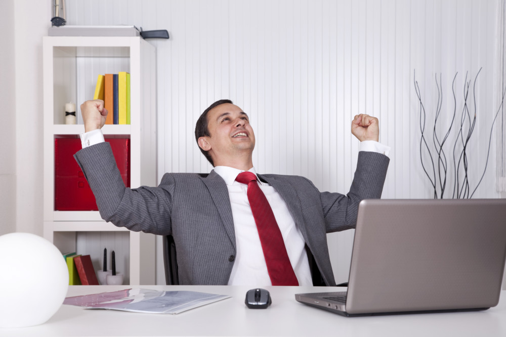 Guy Excited at Computer