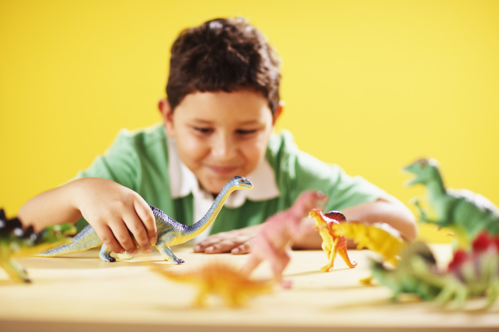 Kid With Dinosaurs