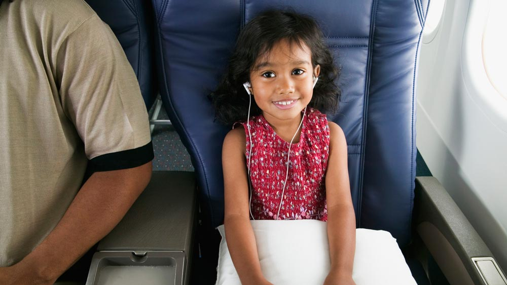 Child riding a JetBlue flight