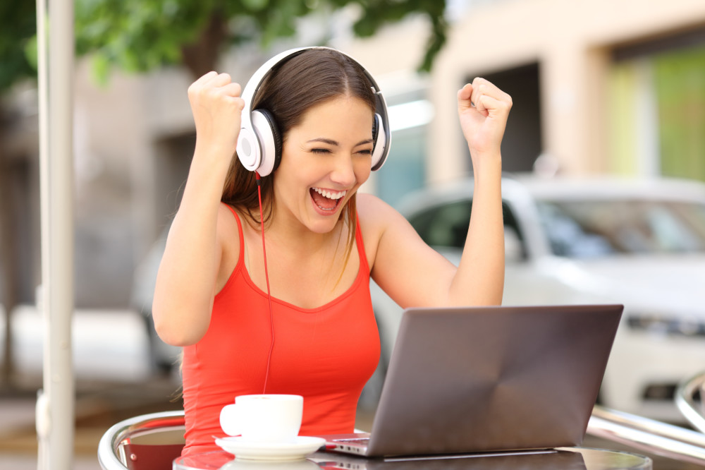 Woman Excited at Computer