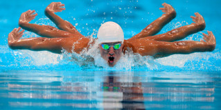 Olympic Swimmer Dominates Competition After Falling in Rio Sewage, Growing Six Arms
