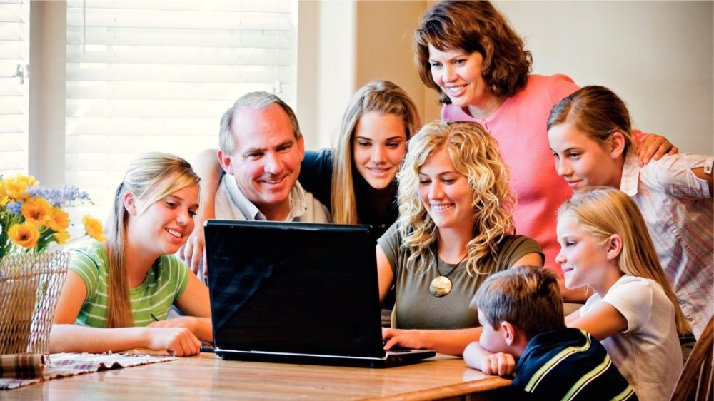 Family Gathered Around Computer