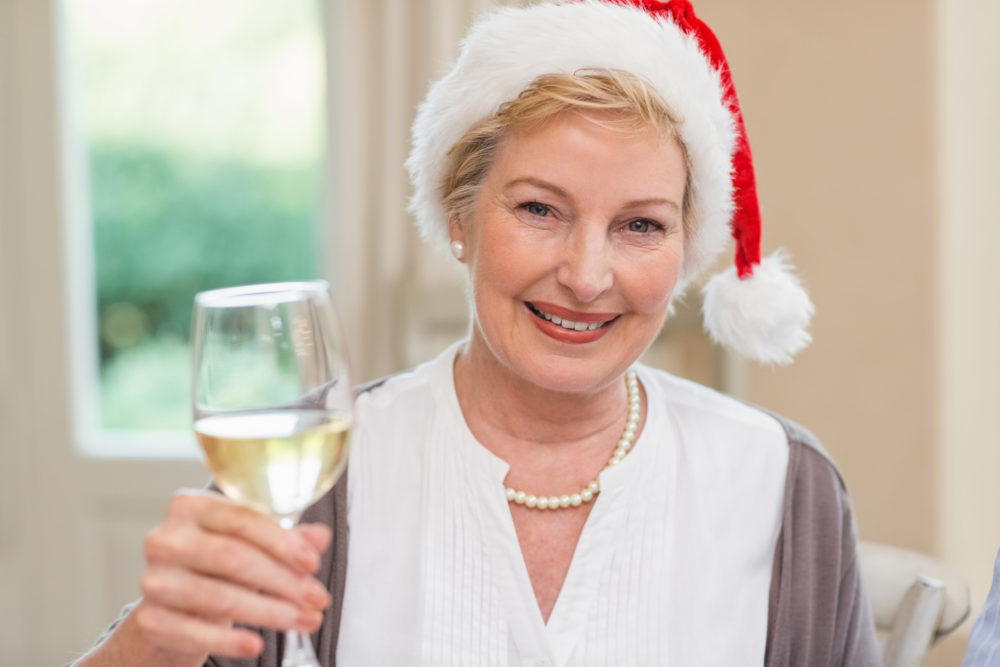 Older Woman Toasting Christmas