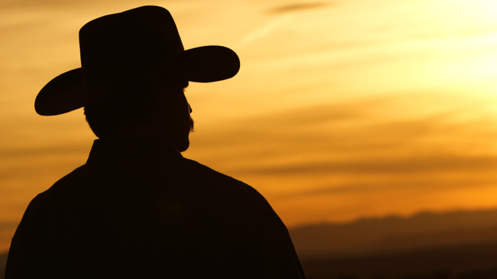 Texan Wonders If Great Big Cowboy Hat Could Help Prevent COVID in Any Way